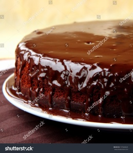 stock-photo-super-chocolate-cake-with-chocolate-sauce-147664625