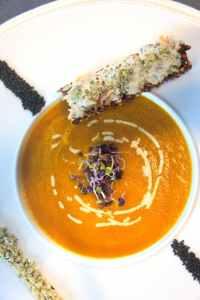 pumpkin soup on white ceramic bowl